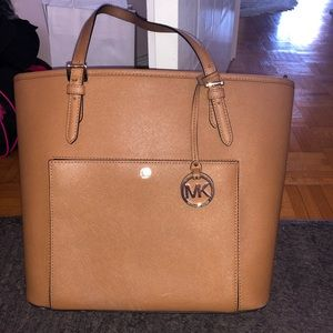 Tan medium sized Michael Kors purse